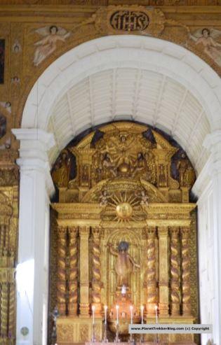 Huge and ornate gilded reredos