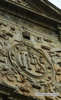 The central rectangular pediment, with the Jesuit emblem 'IHS,' the Latin abbreviation of 'Iesus Hominum Salvator' (Jesus, Saviour of Men)